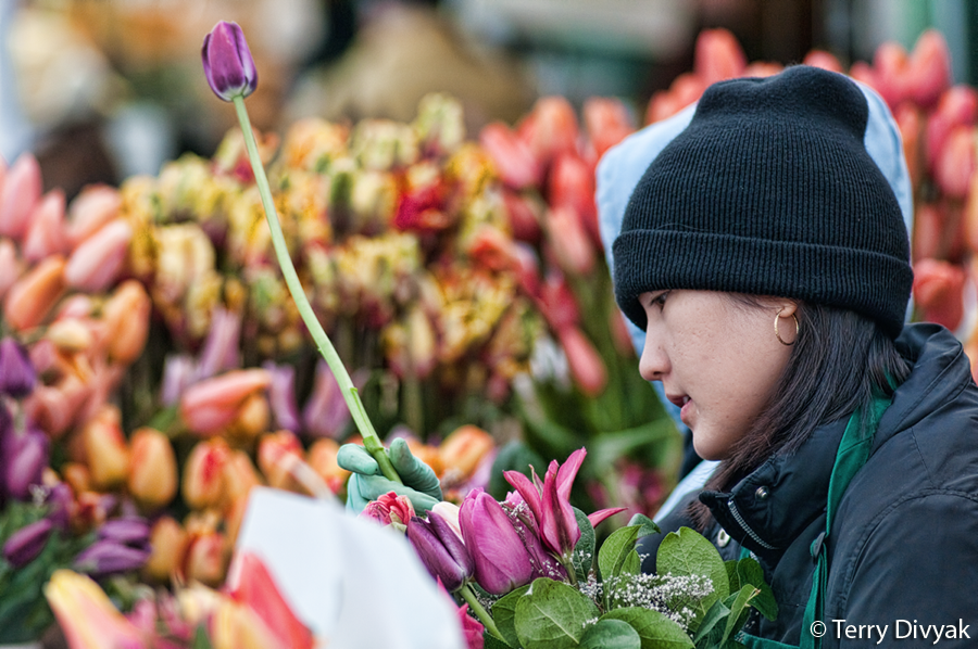 Vendor creating flower bouquets at the Pike Place Market